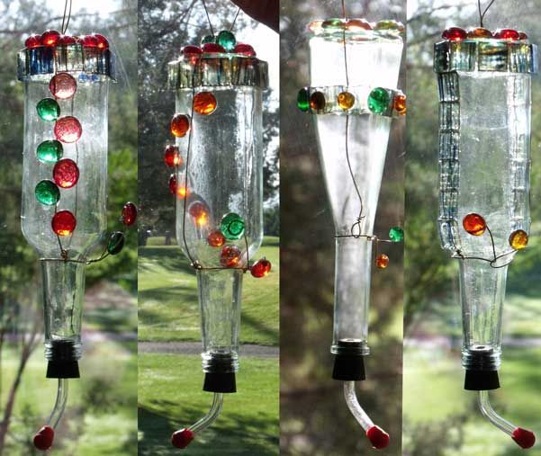 DYI Hummingbird Feeder  You'll need:        A feeder nozzle, available at pet stores, and bird feed suppliers (Portland area: Back Yard Bird Shop has them)      An empty bottle with a neck the right size for the nozzle      Sturdy but flexible wire, roughly 16 gauge      Flat marbles and/or small glass tiles      Wire cutters      Pliers      Glass adhesive such as E6000