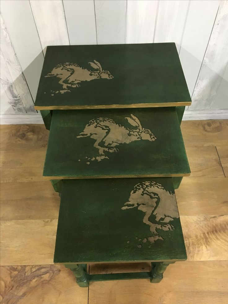 Nesting tables painted in layers of green from the Annie Sloan Chalk Paint Palette: Antibes, Chateau Grey, Florence, and Amsterdam Green; the 3D-effect hare in Graphite French Linen. Sealed with clear and dark waxes, and edges finished with gilding wax.