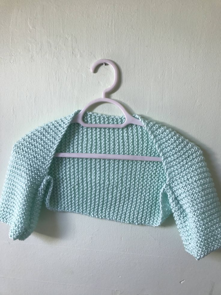 Heading to a wedding, dinner party, prom or formal and looking for something elegant to set off your outfit? Or simply want a cropped top to add a wee bit of heat to your ensemble for a day out? Then look no further. This beautiful hand knit light green bolero shrug will make a gorgeous addition to any outfit, whether it be a formal event, or a Christmas or New Years party. It would also make a lovely gift. I hand knit it using aran yarn in a stunningly beautiful shade of light green that is…