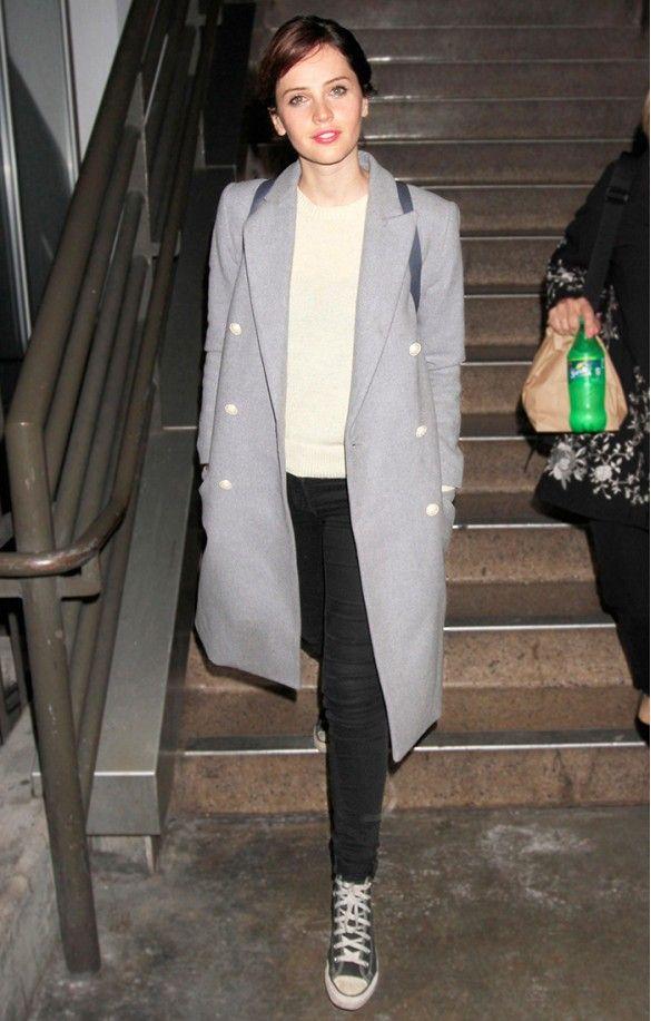 Felicity Jones wore a structured grey coat + black jeans + converse
