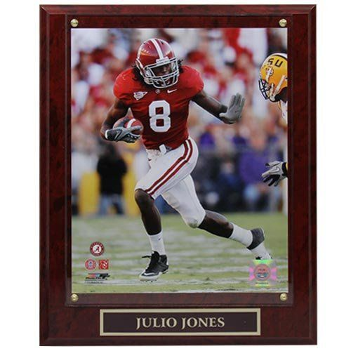 Alabama Crimson Tide #8 Julio Jones 10.5'' x 13'' Player Plaque by Palm. $29.95. Wood frame. High-quality photographic print. Acrylic enclosure. Officially licensed collegiate product. Custom metal name plate. Spruce up your fan cave or office with this Julio Jones player plaque. Featuring a photographic print of Jones in action protected with a thin sheet of mounted plexiglass above a custom engraved name plate all on a vibrant faux marble plaque, this classic collectible is pe...