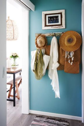 Take a look through the home of stylist, Anna Church,a thoroughly modern seaside shack nestled in the picturesque cove...: Like the color and the hats on the pegs. Great idea for the hall.