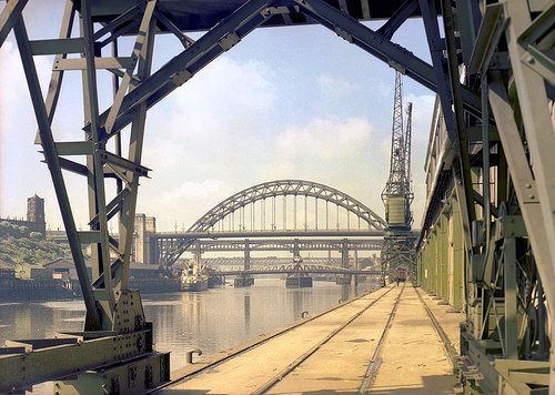 Tyne Bridge, 1960 View of the Tyne Bridge from the Quayside, Newcastle upon Tyne, July 1960, taken by the Newcastle-based photographers Turners Ltd. The firm was regularly commissioned by local businesses to take photographs of their products and their premises. Turners also sometimes took aerial and street views on their own account and many of those images have survived, giving us a fascinating glimpse of life in the North East of England in the second half of the 20th century.