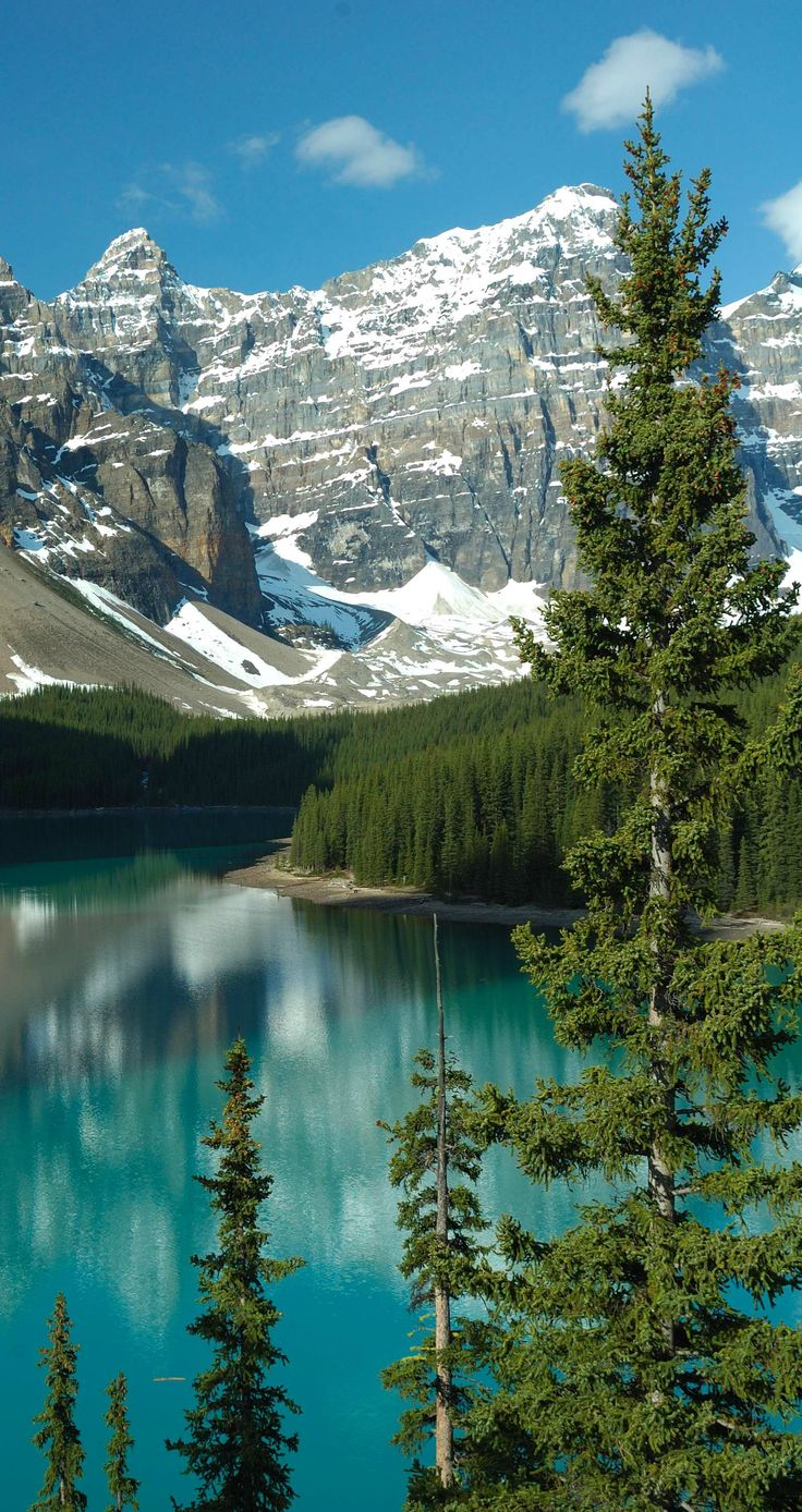 This is the beautiful Moraine Lake ~ located in the Canadian Rockies, near Alberta, Canada. Curt Rosner Photography