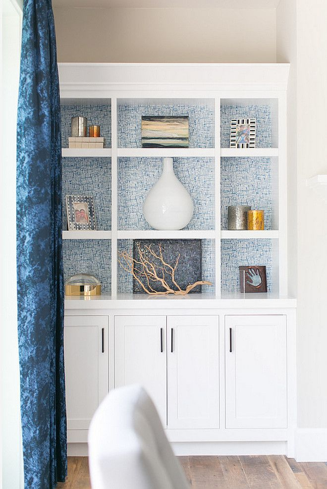 The perfect odds and ends find a place in this built-in storage cabinet backed with printed wallpaper and complete with cabinet storage | Brooke Wagner Design