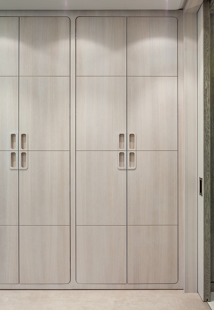 gorgeous whitewashed closet cabinets with inset handles flush inset doors and curved corners