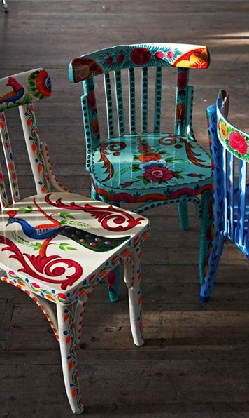I have four plain pine chairs coveted with decorating related paint splatter...wonder how the fella would feel about flowery chairs!