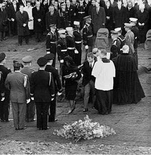 Nov 25, 1963 - foreign, civilian and military dignitaries at the gravesite at Arlington National Cemetery. Jackie lights the eternal flame, and she passes it to Robert to light and he to Edward. Jacqueline and Robert talk to Catholic Prelates who had taken part in the funeral service. Jacqueline kisses the cheek of General Maxwell D Taylor, Chairman of Joint Chiefs of Staff. Jacqueline leaves the grave site with Robert Kennedy. Jet fighters fly over the cemetery in salute.
