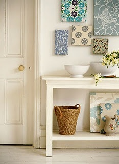 Fabric covered show box lids can adorn your walls - Like a stretched canvas print - AWESOME!  I am making these~