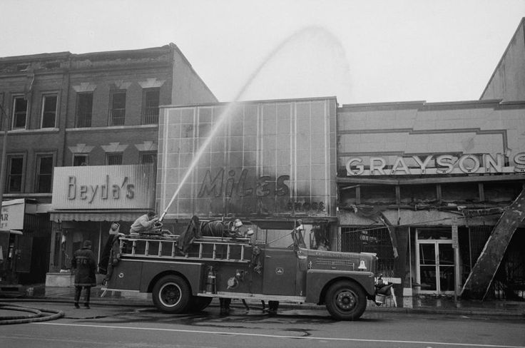Firefighters spraying water on shops, including Beyda's, Miles Shoes, and Graysons, that were burned during the riots that followed the assassination of Martin Luther King, Jr., April 1968. REUTERS/Library of Congress