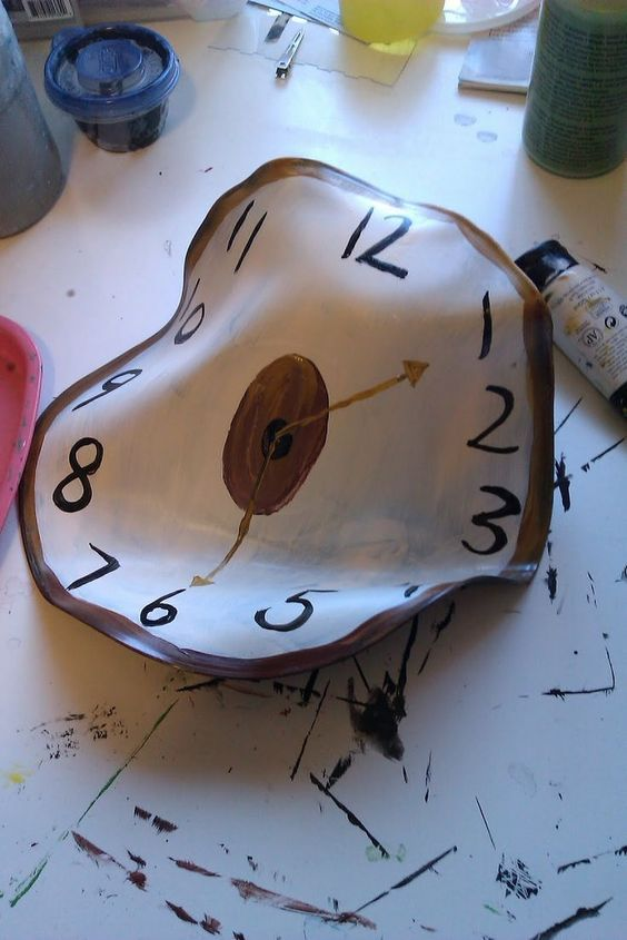 I love Salvador Dali. When you hear his name you immediately think of his clocks. This would be a good project for high schoolers. You take old records and melt them into different shapes, then the students paint on the clocks with acrylic paint.