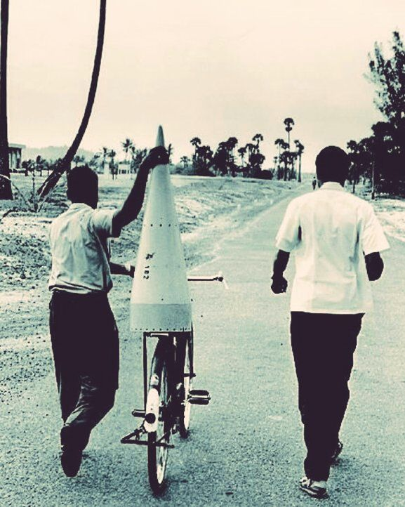 """Prasar Bharati on Twitter: """"History in the Picx: 1963:: ISRO staff transporting the nose cone of a rocket on bicycle at Thumba, Kerala. https://t.co/wUgMSDsifd"""""""