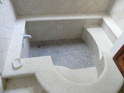 Sunken tub with steps and seat...it's like an indoor hot tub..gonna need a bigger water heater