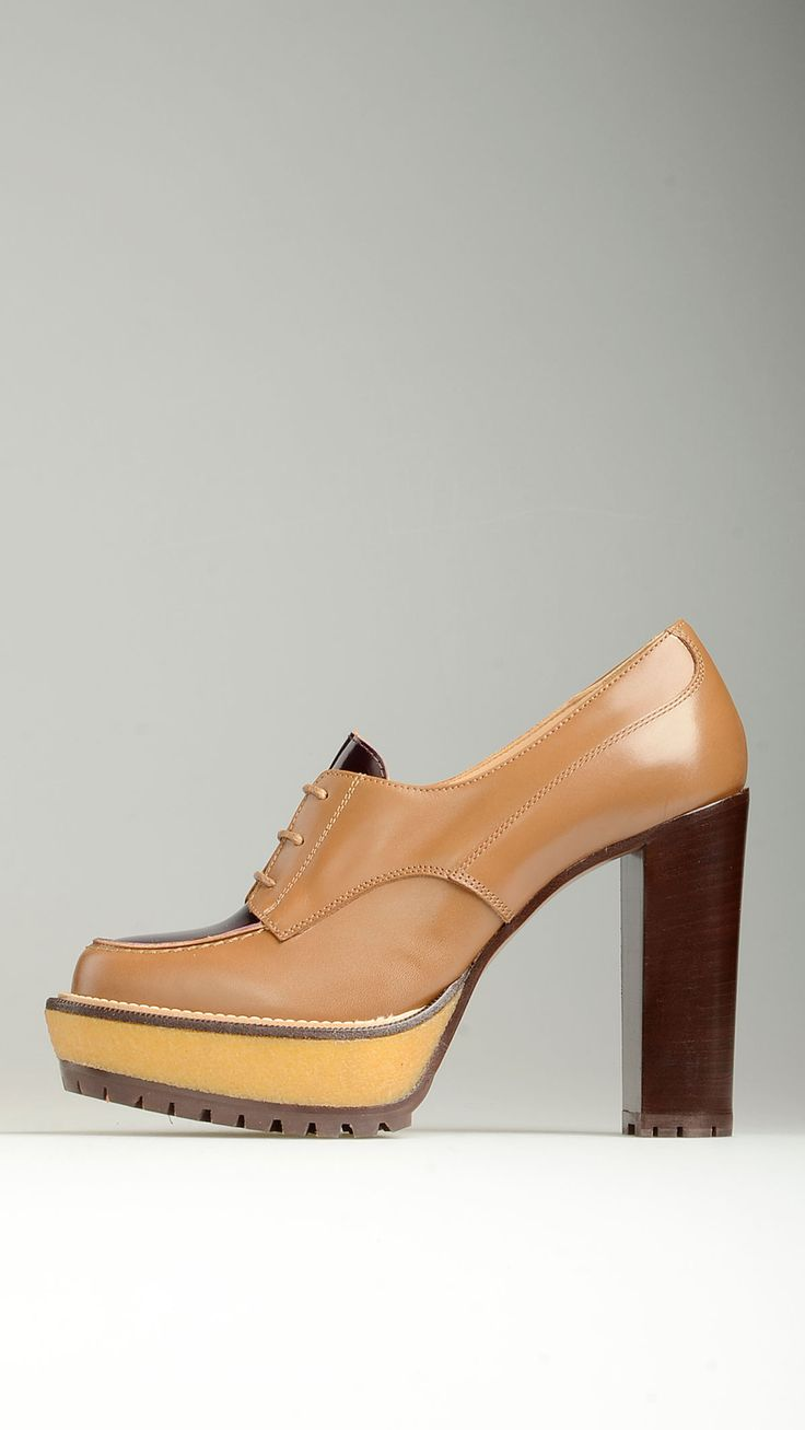 Plum patent leather tongue embellished heeled lace-ups shoes, contrast stitching, 1.1'' vulcanized rubber platform, 4.7'' planking heel, grip fast rubber sole, 100% leather.
