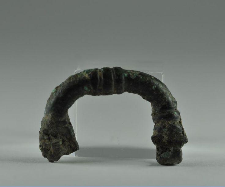 Phrygian bronze fibula, 6th century B.C. 3.5 cm long. Private collection