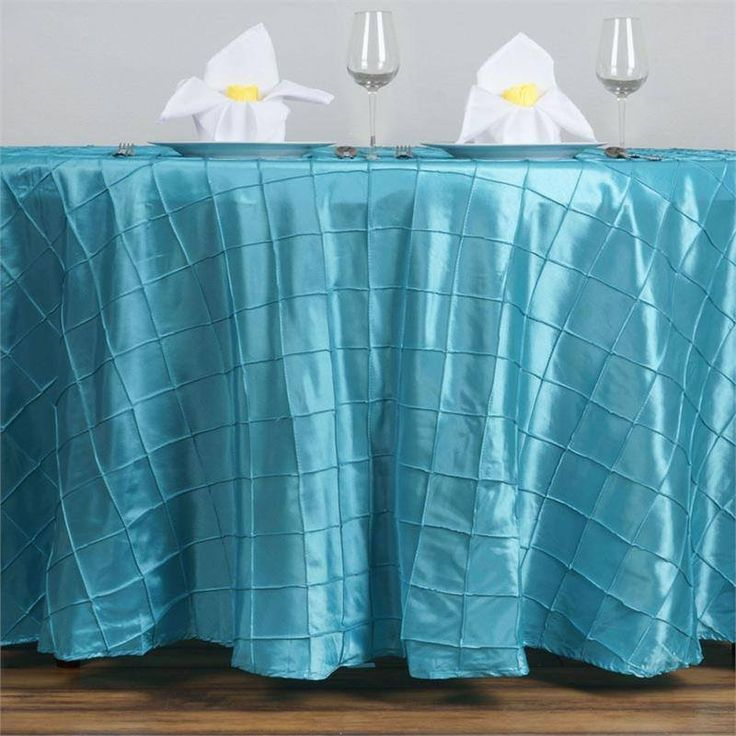"""Turquoise Pintuck Tablecloths 120"""" Round - Pintuck is actually a fold of fabric that is stitched intricately to hold it in a place, very much like a pleat. These lovely pleats impart a decorative effect to the fabric by fashioning a visual line at a chosen point. They effortlessly bridge vintage and contemporary styles to create a majestic new classic look. If you do not want your celebration to blend in with other weddings, birthdays, and anniversaries, try our premium quality pintuck…"""
