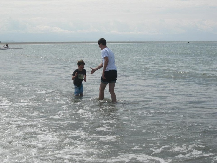 With little cousin-Ethan (about to get tricked and thrown in the water) at Tahunanui beach, Nelson NZ