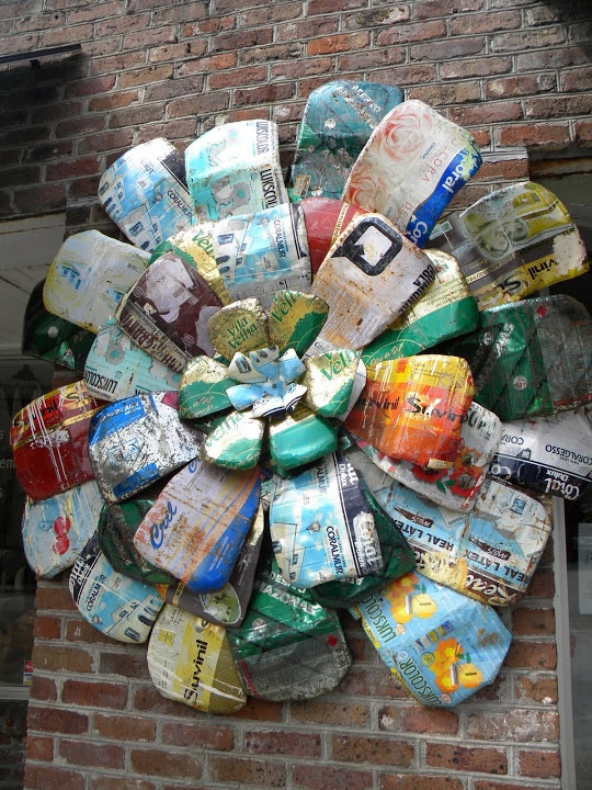 """Soda cans make a colorful """"flower"""" for your garden - I'm thinking this is a summer DIY for SURE!!!!!!!!"""