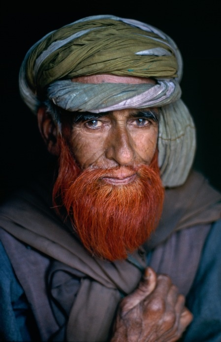 Kuchi shepherd, Kashmir. Amazing bright red beard he has. Genetic mutation not common in that part of the world. But at some point during the silk and spice trading, the mutated gene was introduced into this mans ancestral family. So cool!