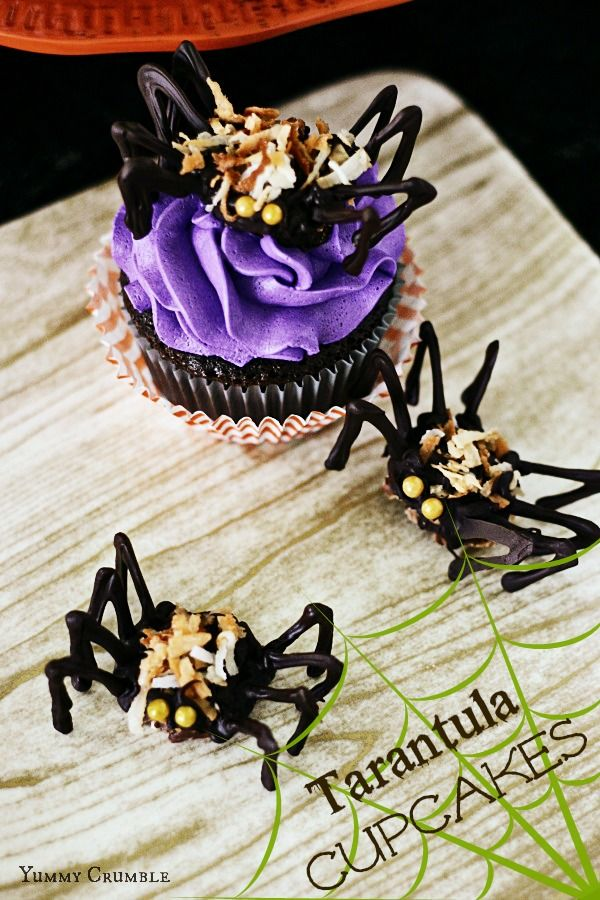 chocolate tarantula cupcakes that are perfect for halloween chocolate cupcakes topped with purple vanilla buttercream and adorable chocolate spiders - Halloween Chocolate Spiders