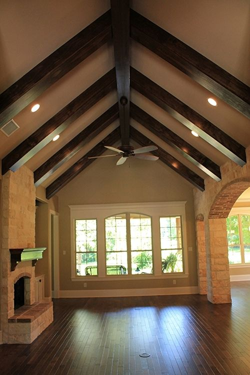 Beams living room home pinterest for Home plans with vaulted ceilings