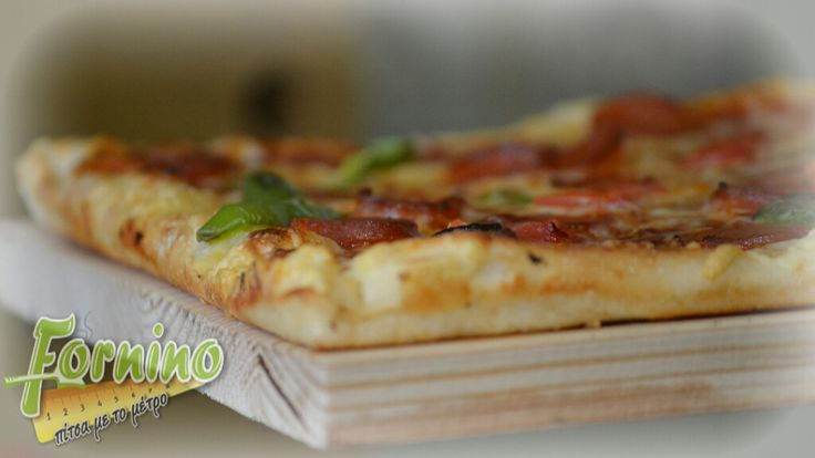 Pizza Vivaldi, with cheese mix, slices of fresh tomato, mozzarella, parmesan, basil and virgin olive oil.. Just perfect!