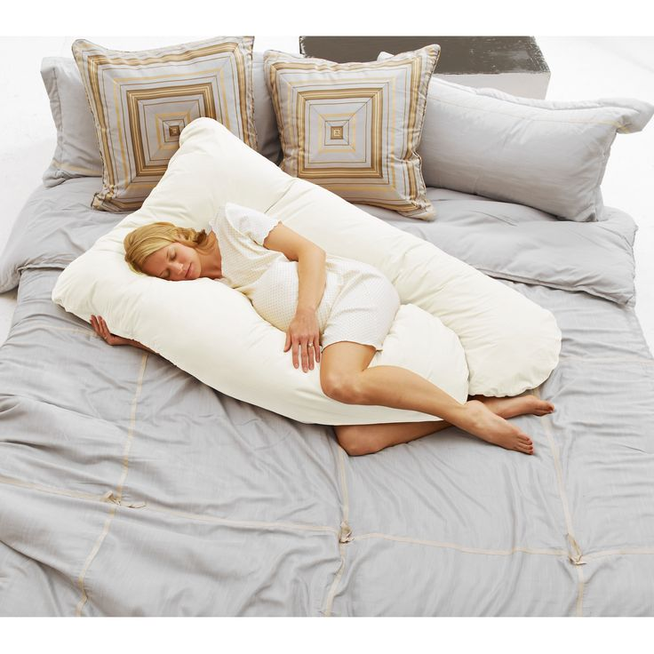 The Today's Mom Cozy Comfort pregnancy pillow lets you get a good night of sleep throughout your pregnancy. The unique shape of this body pillow helps support your belly, legs, and back, and the 200 thread count material is durable and soft.
