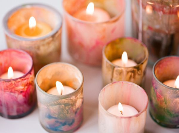 DIY Painted Votives:  The glass Michelle uses to clean her brushes inspired us to paint the insides of these votives for some colorful candlelight. They couldn't be easier to make. Pick up a case of glass votives from your nearest floral wholesaler or local Target. Scribble watery paint on the inside of clear glass candleholders and don't try too hard…if you mess with them too much you'll just make brown.