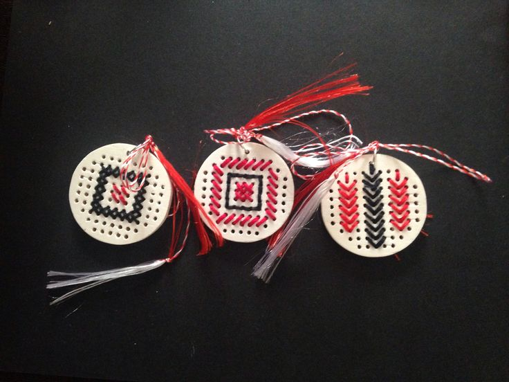 On the 1st of March, Romanians, Bulgarians and a couple more guys celebrate Mãrțișorul - the coming of spring. Girls get to wear little broches with the red-white string attached. I made these for my girl friends and my daughter's teachers. #romanian #pattern #traditional #cross-stitch #spring #tradition #handmade