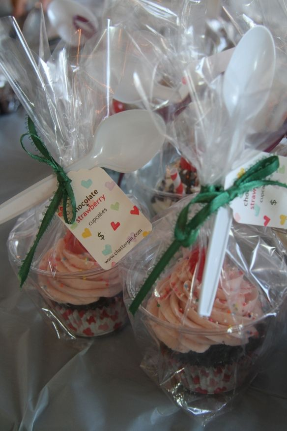 Cupcake in a plastic cup to protect icing - bake sale idea