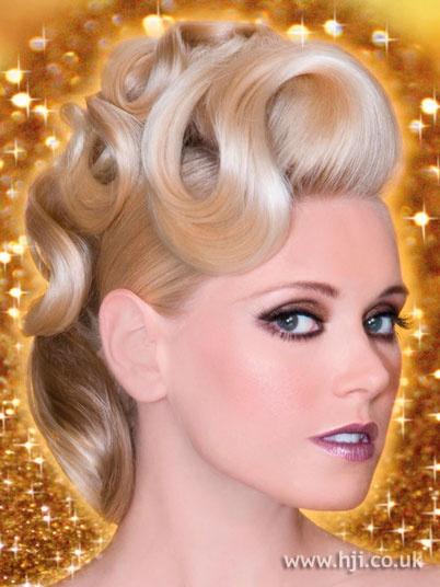 2009 blonde curls hairstyle    Hair was styled with a large barrel tong, with curls smoothed through with shine cr�me and pinned in place on top of the head.    Hairstyle by: Patrick Cameron  Hairstyle picture by: Alastair Hughes