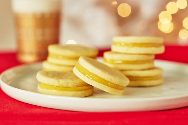 Stop the search — you've found your new addition to this year's lineup of holiday cookies. This lemon curd sandwich cookie starts off with just-sweet-enough cookies, made rich and tender by a simple cream cheese dough. Don't expect to find a snappy cookie here — these rounds have some give because we want them to melt a bit when you bite into them. Nestled inside is a sunny, tart and sweet lemon curd. Thanks to those tender cookies, the curd won't smoosh out when you bite them. Consider this…