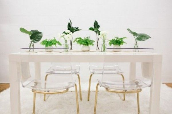 Ikea lucite chairs spraypainted gold