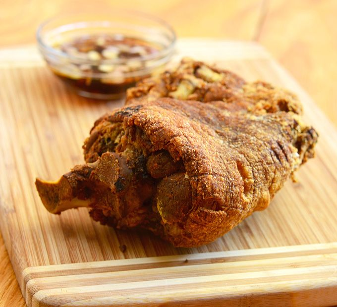 Crispy Pataa is a whole pork leg is simmered in spices until fork-tender, refrigerated overnight to dry and then deep-fried until the meat is moist and succulent and the skin golden and crisp