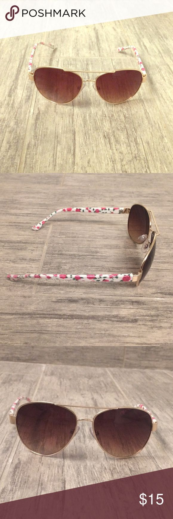 Aviator Sunglasses Very cute gold aviator sunglasses with floral print arms. The lenses are amber. Perfect for summer and in great condition! Accessories Sunglasses