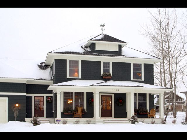 Black house exterior with white trim - Classic American four square - Traditional home exterior in the snow - By: Ron Brenner Architects in Stillwater, MN