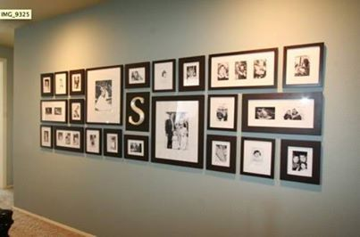 Black and white photos on a long wall
