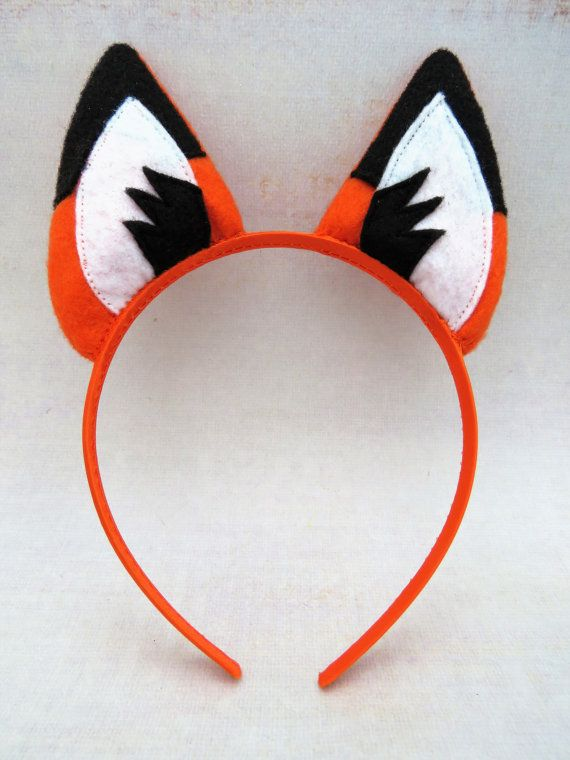 Woodland fox ears for dress-up play or to add to a costume. The ears are made from orange felt and are firmly stitched to a satin covered headband. Will fit most children and adults (not toddlers or babies). Please spot wash only. Height of ears is approximately 3 (7.6 cm) and width of headband is 3/8 (9.7 cm) --------------------------------------------------------------------- Ships from Canada. SHIPPING INFO: In order to keep shipping charges as low as possible I ship mostly via Canad...