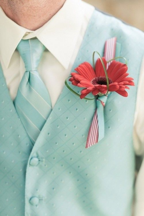 Red gerbera and light blue waistcoat - ingredients for a successful 50s Retro Wedding.