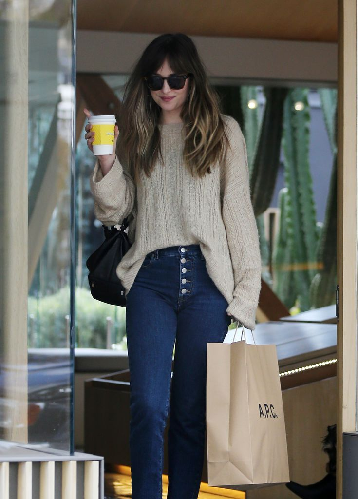 How can she be so flawless! Dakota Johnson was seen shopping on Melrose Place in…