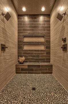 Awesome shower with Sliced Black pebble tile shower pan tile.