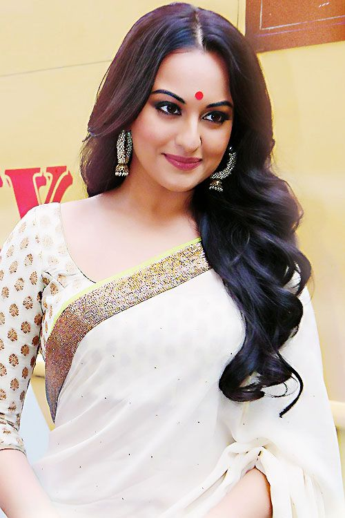 Sonakshi Sinha in white and gold saree. Love the hair, blouse, bindi, and earrings. She is gorgeous!