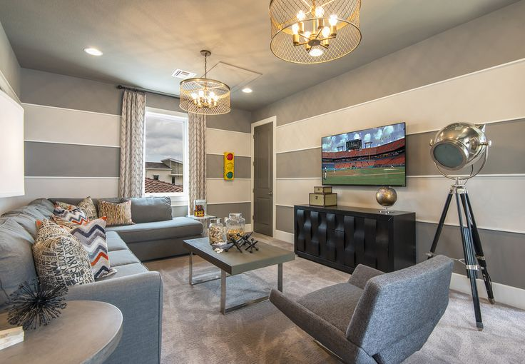 This teen's hangout room is sophisticated, yet functional, and showcases double hanging light fixtures, horizontal applied trim moulding with accent paint