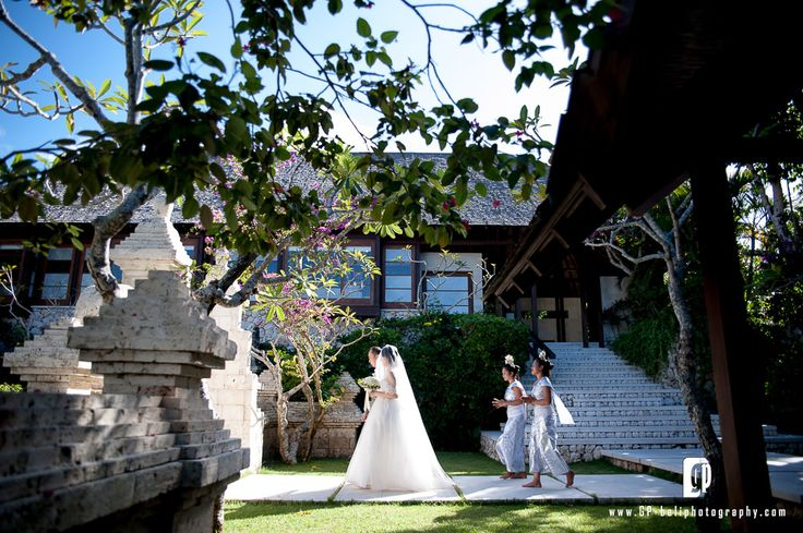 With her father on the right side, The bride was ready to walk in to the chapel, to meet her beloved groom.