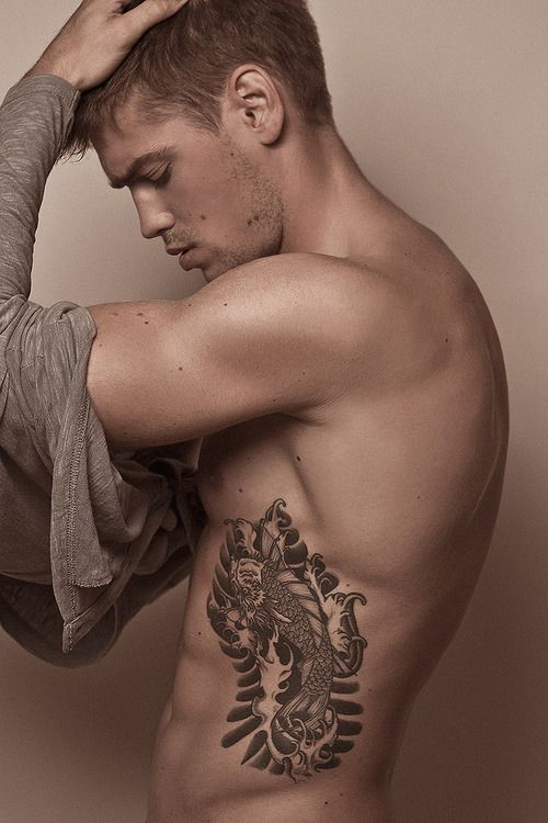 Tattooed guy. #tattoo #tattoos #ink, that's smoking hawt, oh and the guy isn't half bad either