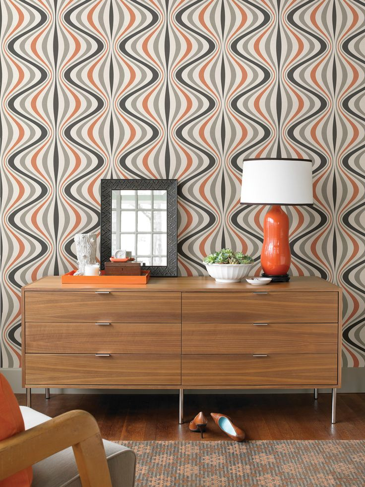 A groovy bedroom decor idea with a mod wallpaper feature wall