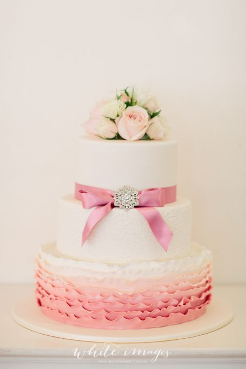 pink and white wedding cake, ombre ruffles fresh flowers by Tiffany's flowers, white images