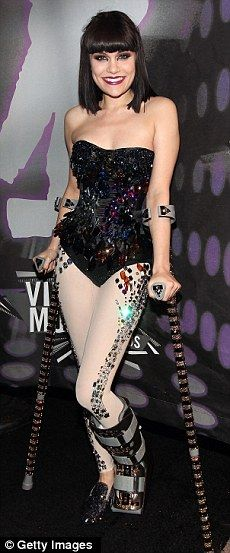 Still crocked: Jessie J is still hobbling around on crutches at VMAs as broken…