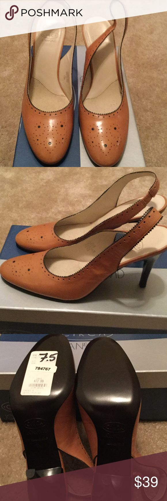 CIRCA Joan & David Leather Slingback New in box. CIRCA Joan & David carmel with black trim leather sling back. These shoes are beautiful. Size 7 1/2 M . Joan & David Shoes Heels