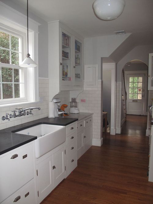 ★ Favorite--Clean lines in a 1930s Colonial Revival.  Brackets under cabinets, tile up wall, old-style lower cabs